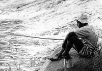 Boy fishing at Waterfalls, a suburb of Harare (then Salisbury), 1950s - By Brian Barratt